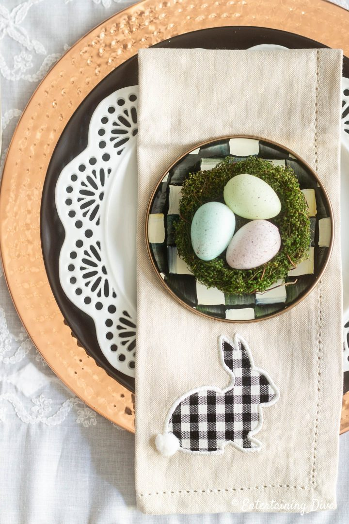 Black, white and copper Easter table setting with Easter egg nest