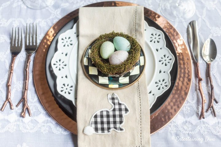Black, white and copper Easter table setting with copper twig cutlery and buffalo check napkins