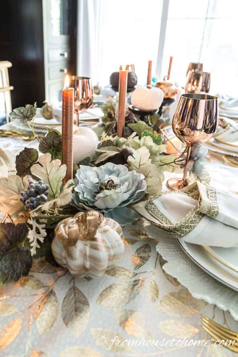 Copper fall table centerpiece with vines and copper candles