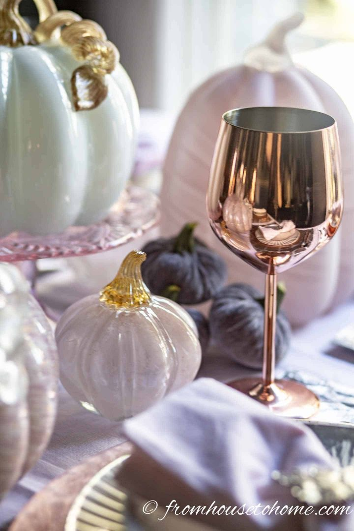 Copper wine glass with pink pumpkin centerpiece