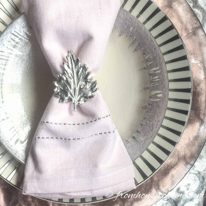 Pink and silver place setting with leaf-shaped napkin ring