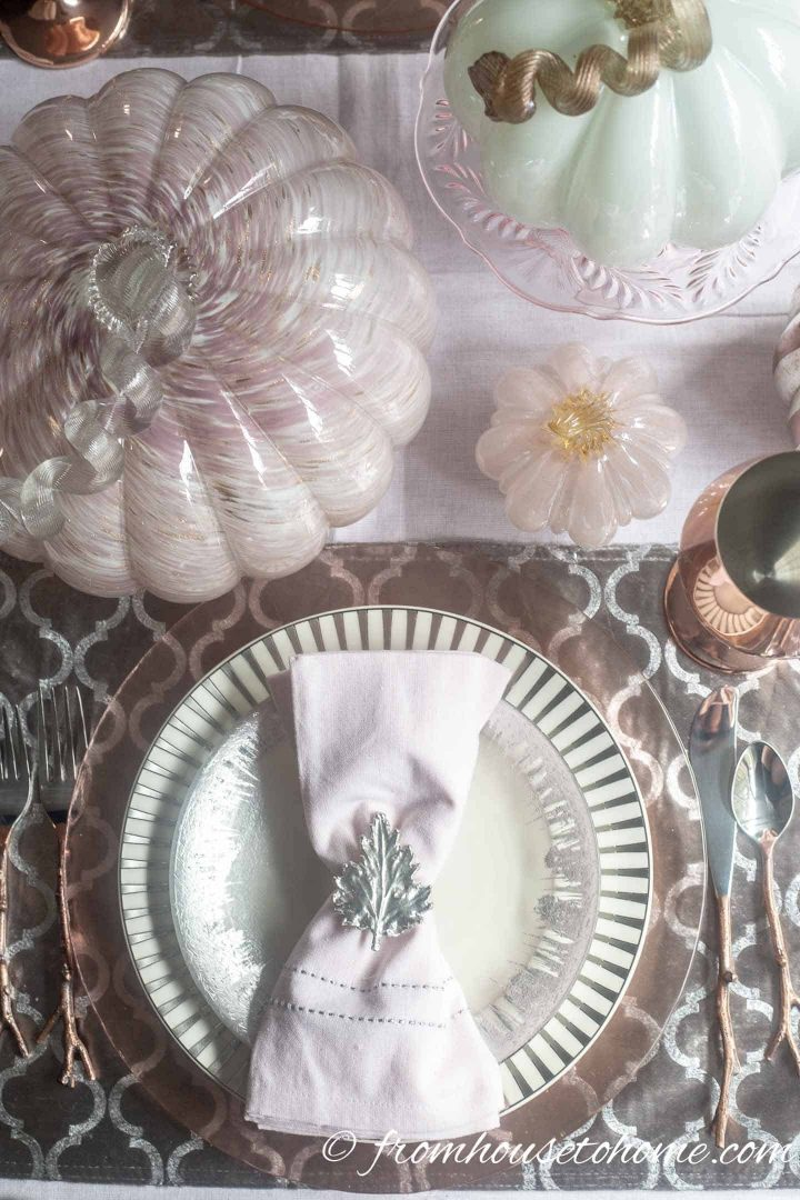 Pink and silver fall table setting with pink pumpkins