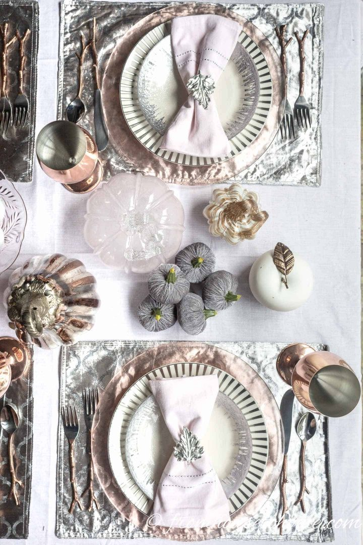 Pink, copper and silver place settings on a fall tablescape