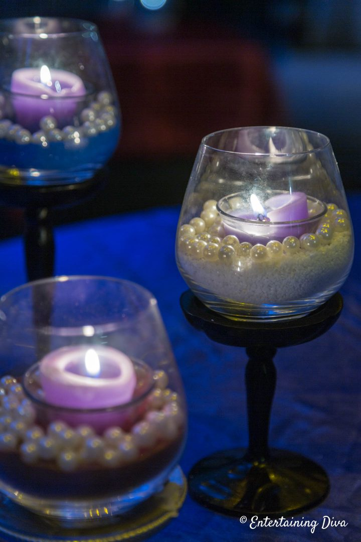 White and blue DIY pearl and sand candle holders at night