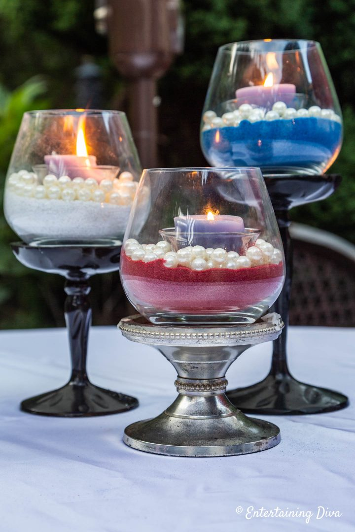 DIY pearl and sand candle holders in red, white and blue used for a 4th of July party