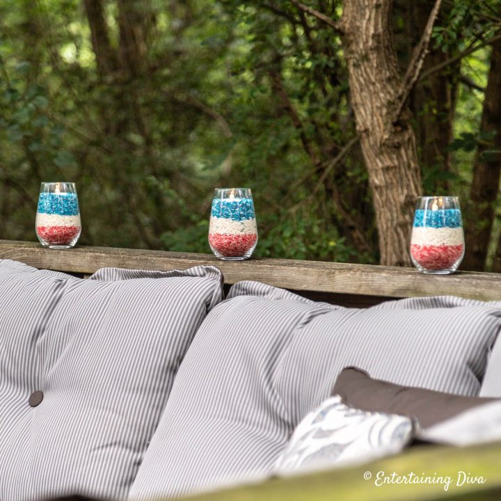 Red, white and blue rice candles along the deck railing for American Independence Day