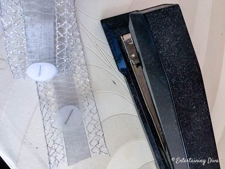 Velcro dots attached to ribbon with staples