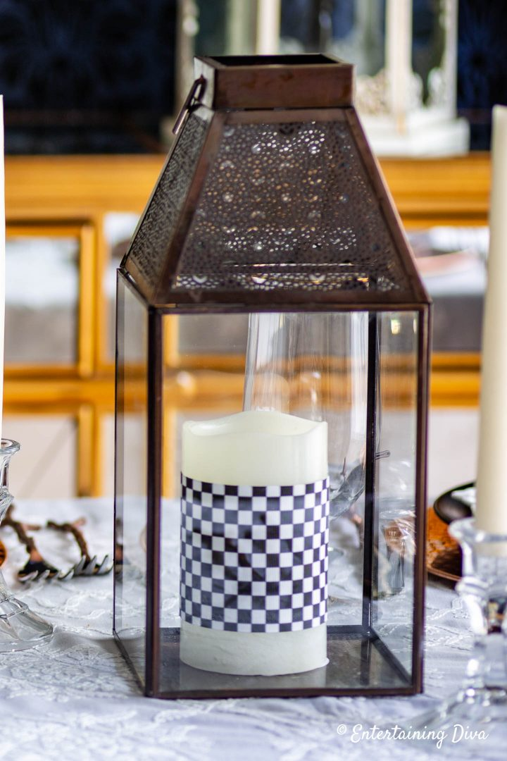 DIY ribbon candle made with black and white checkered ribbon