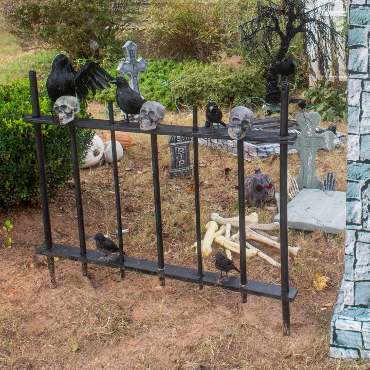 DIY Halloween picket fence in front of a graveyard