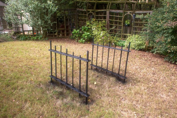 The DIY Halloween cemetery picket fence spray painted black