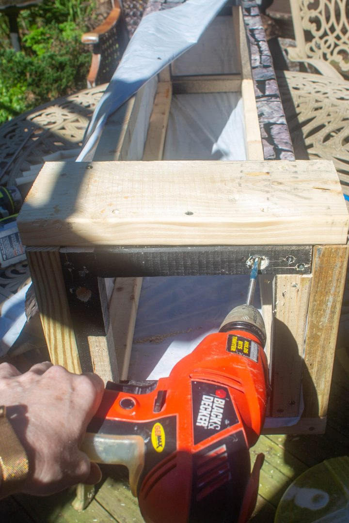Drilling holes in the column frame for stakes