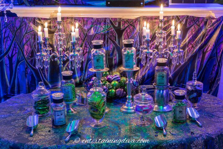 Maleficent party candy buffet with green and purple candies