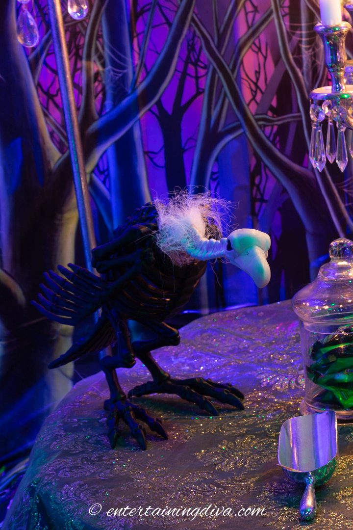 Maleficent party decor with a buzzard on a table