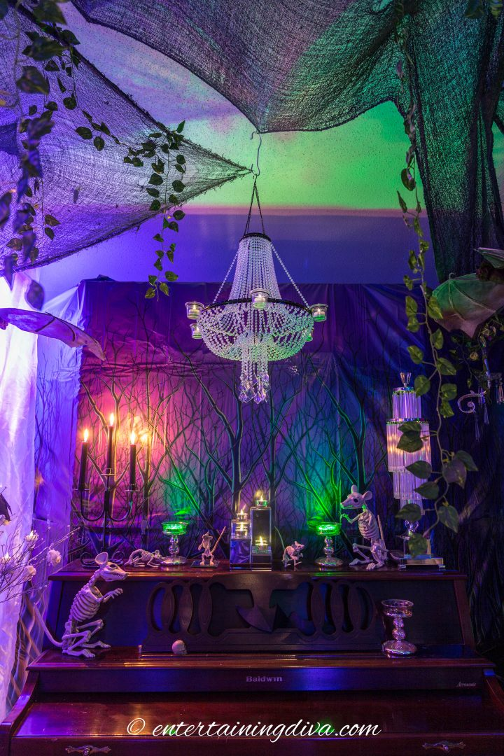 Halloween party decor with skeleton mice on the piano