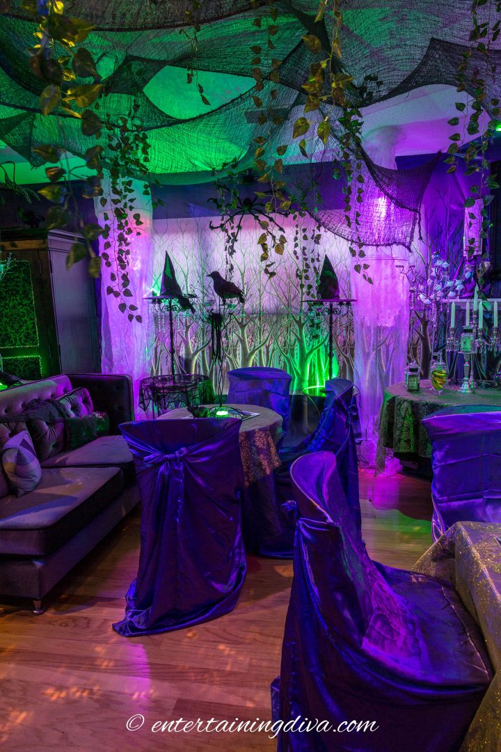 Maleficent party decor with purple chair covers