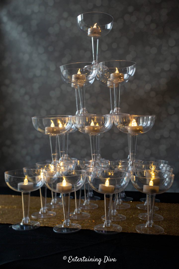 The DIY champagne glass tower used as a candle centerpiece