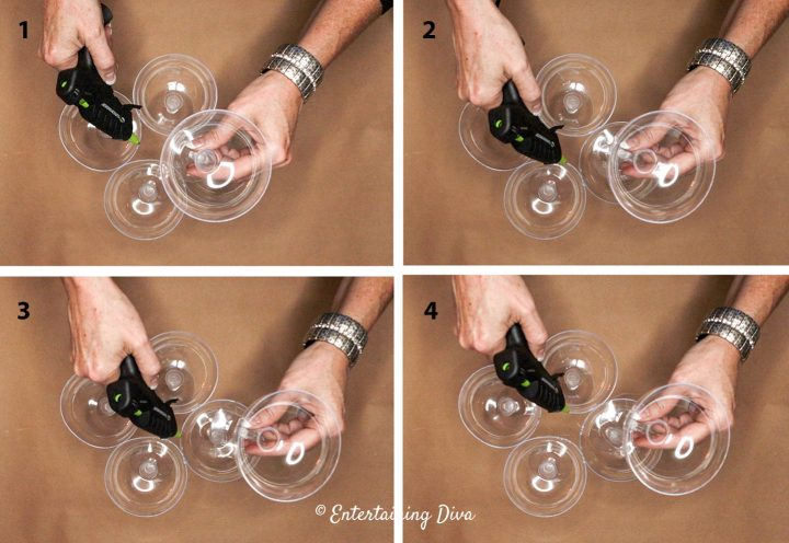 Hot glue the top of the champagne glasses