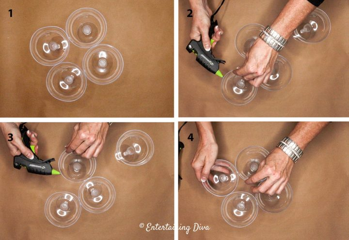 Hot glue the edges of the champagne glasses together