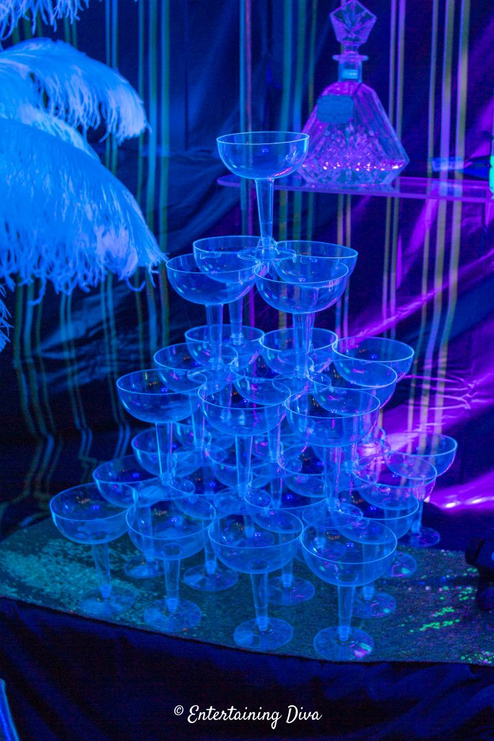 The DIY champagne glass tower under black lights
