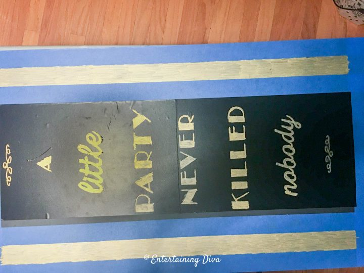 The DIY Gatsby chalkboard sign stencil completely colored in with gold chalk marker