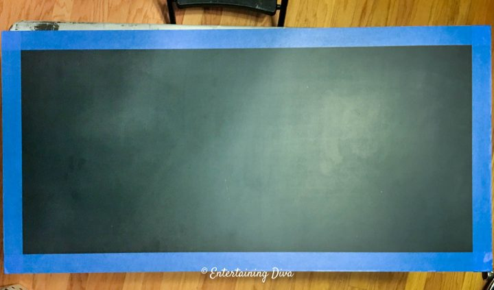 Tape around the edge of the chalkboard
