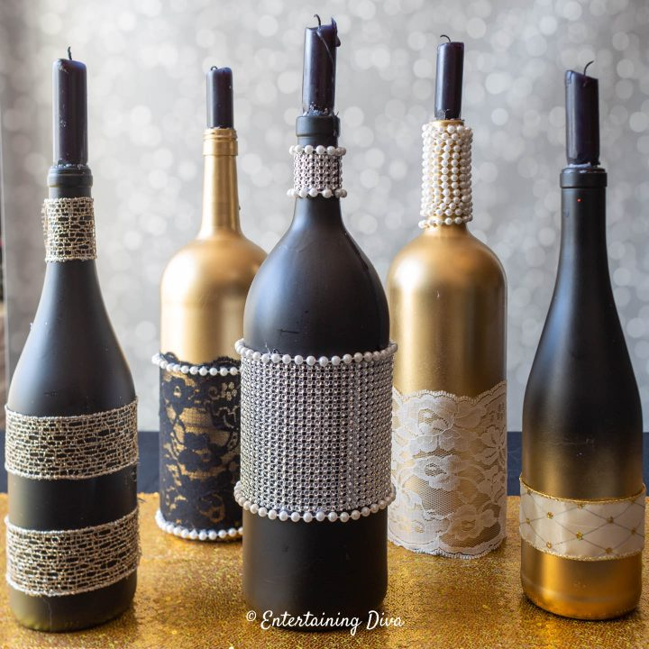 The finished DIY wine bottle centerpieces with candles