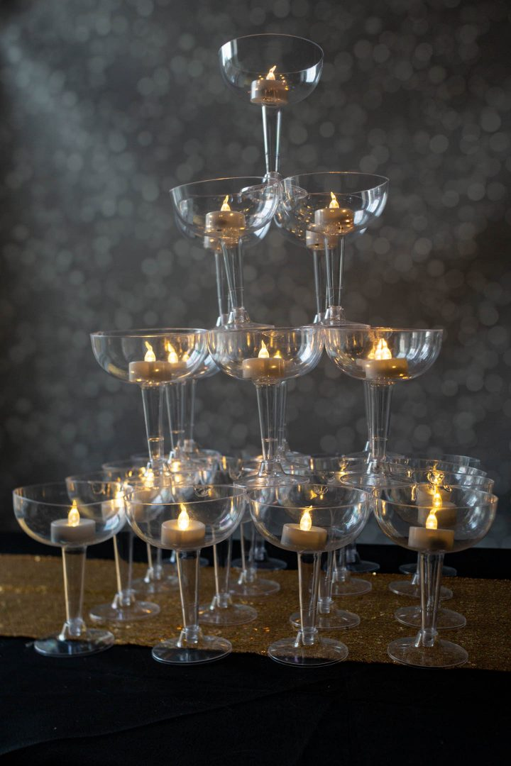Champagne glass tower with flameless tealight candles for a centerpiece
