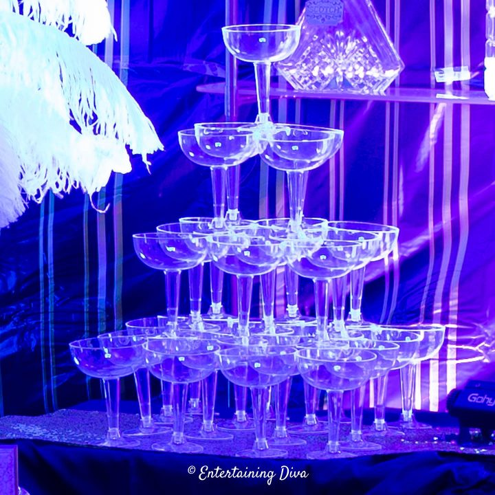 Champagne glass tower on the bar at a roaring 20s party