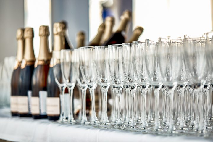 Champagne bottles and glasses at a drink station