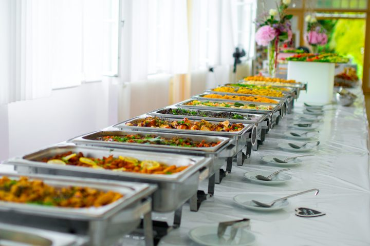 Long line of chafing dishes against the wall