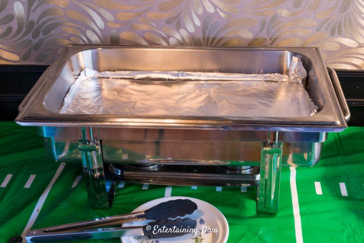 Large chafing dish lined with foil for easy clean up