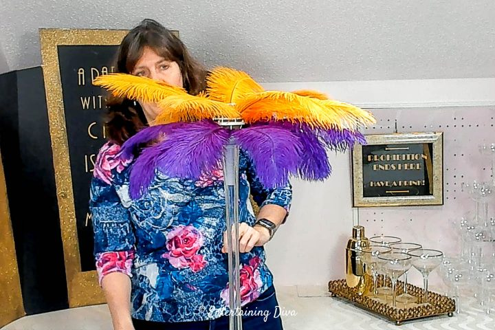 Purple and gold ostrich feathers added to the centerpiece