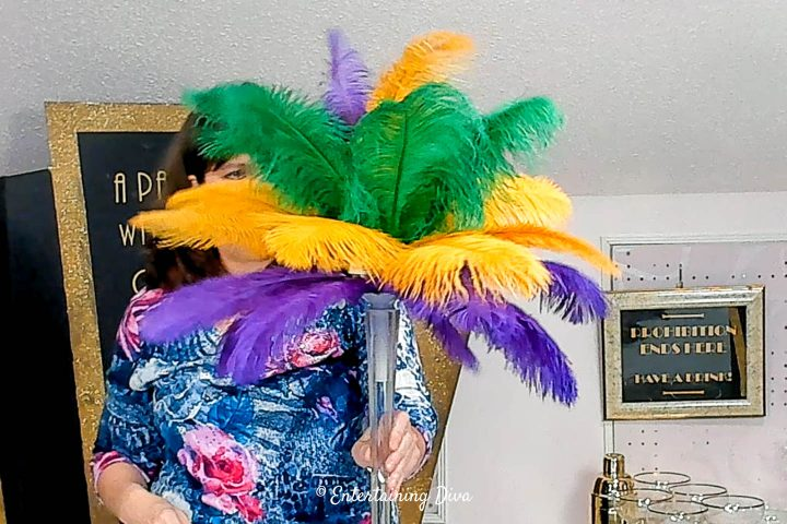All of the feathers added to the DIY Mardi Gras feather centerpiece