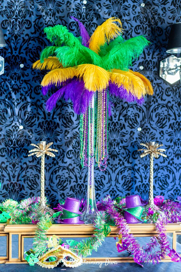 DIY Mardi Gras feather centerpiece with other Mardi Gras party decor