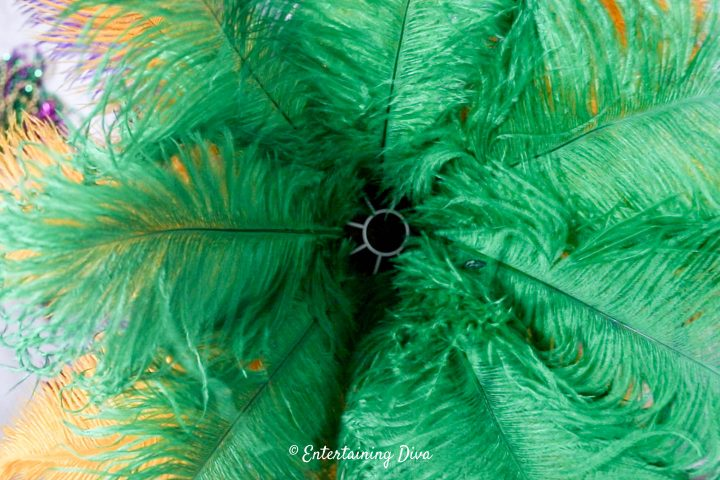Green ostrich feathers are the third layer of the centerpiece
