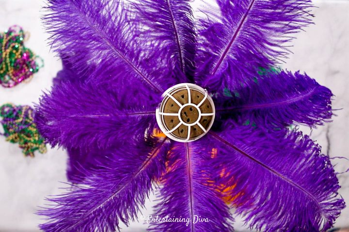 Eight purple feathers in the bottom layer of the Mardi Gras centerpiece