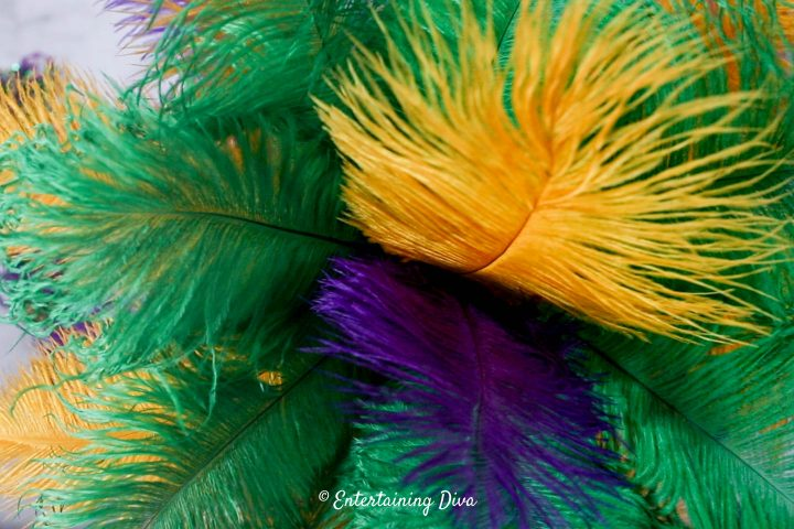 Purple and gold ostrich feathers added to the top of the Mardi Gras centerpiece