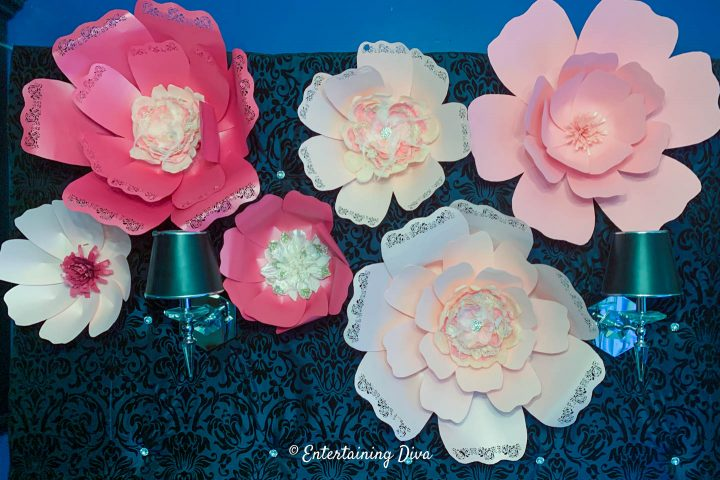 DIY giant paper flowers on an upholstered backdrop