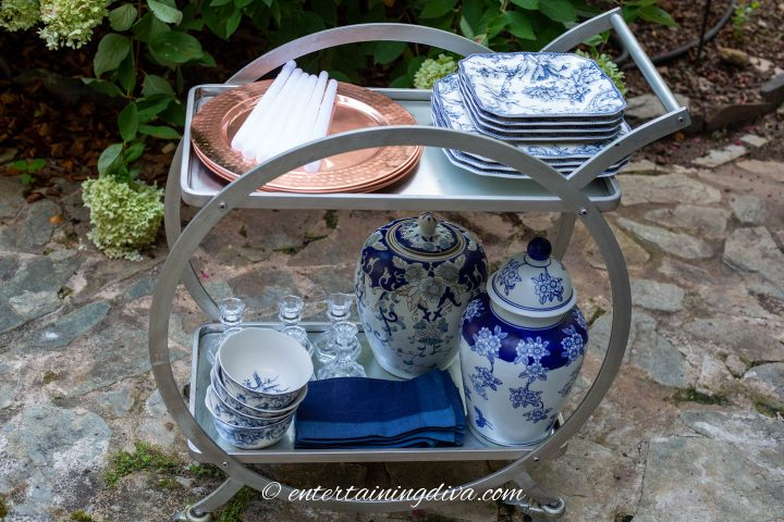 Bar cart with dishes on an outdoor patio