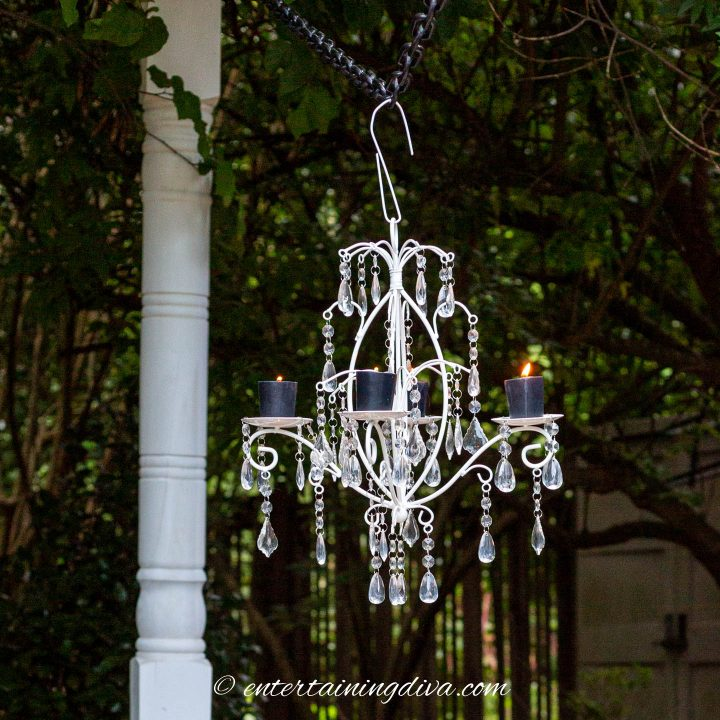 White candle chandelier hung from a temporary outdoor light pole