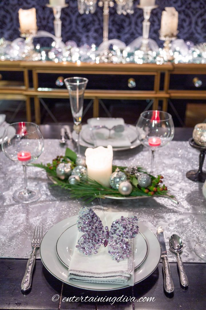Silver and white Christmas table setting with an easy and elegant Christmas centerpiece