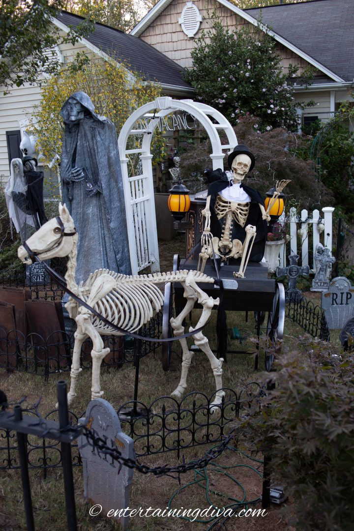 Skeleton horse and hearse carriage in a Halloween yard haunt