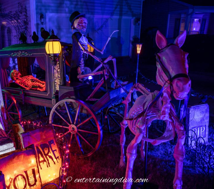 The Halloween skeleton horse and carriage lit up at night