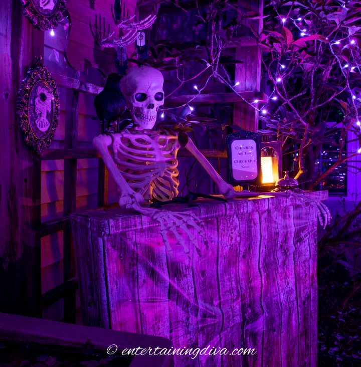 The haunted hotel check in desk lit up at night