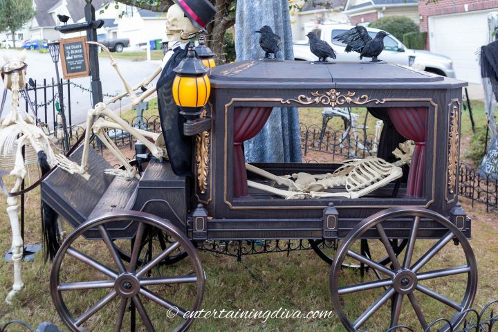 The side view of the Halloween hearse with a skeleton in the back