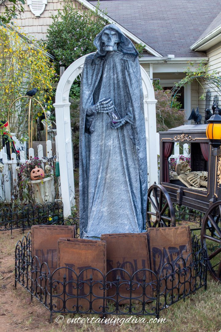 Large Halloween grim reaper statue in the middle of the yard