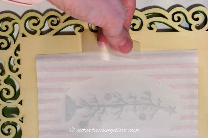 How to attach the picture to the frame