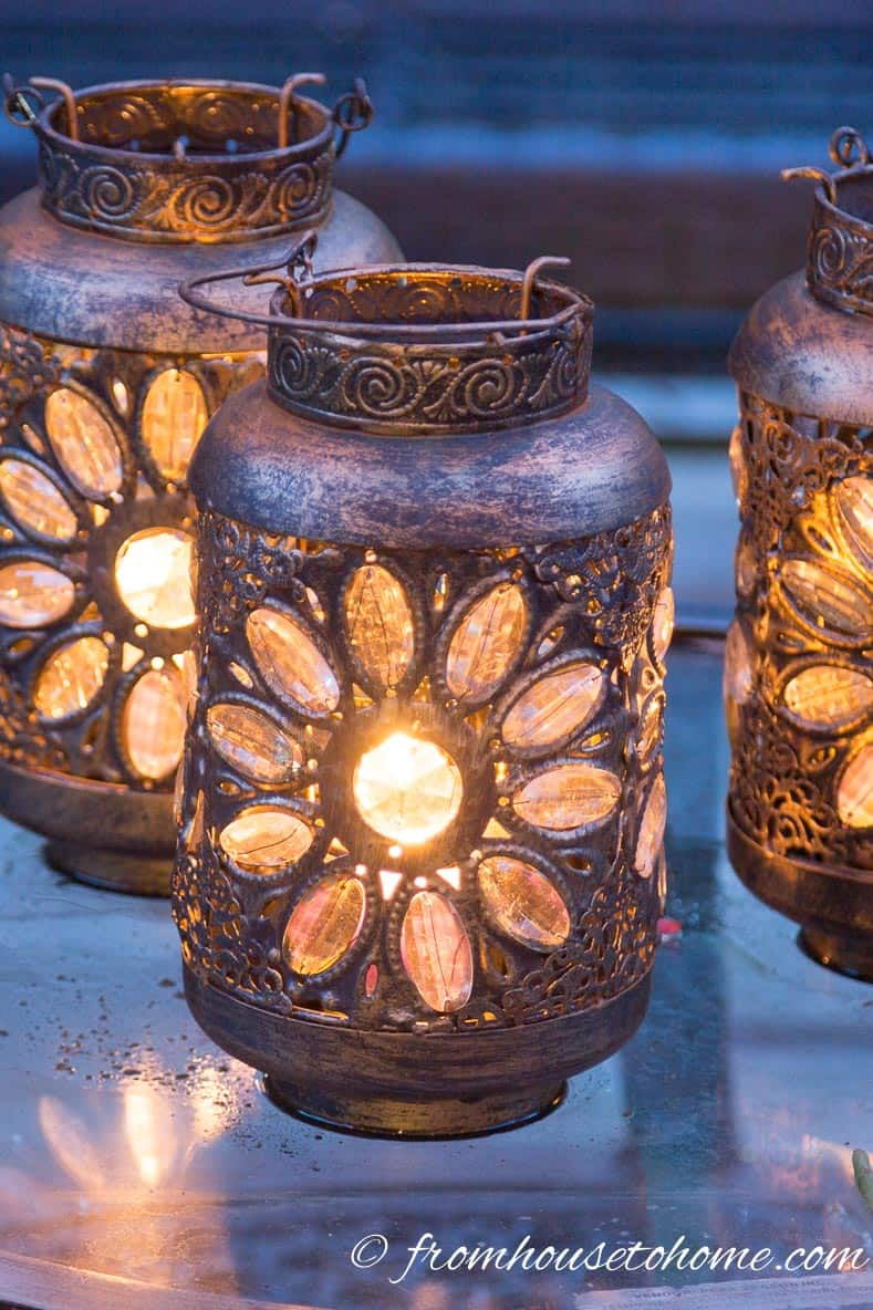 Lanterns are inexpensive outdoor decorative lighting | 8 Landscape Lighting Effects And How To Use Them | Whether you're looking for DIY landscape lighting ideas for your front yard, backyard or walkway, this list will help! It shows you lots of ways to use both low voltage and solar lights in your garden or patio.
