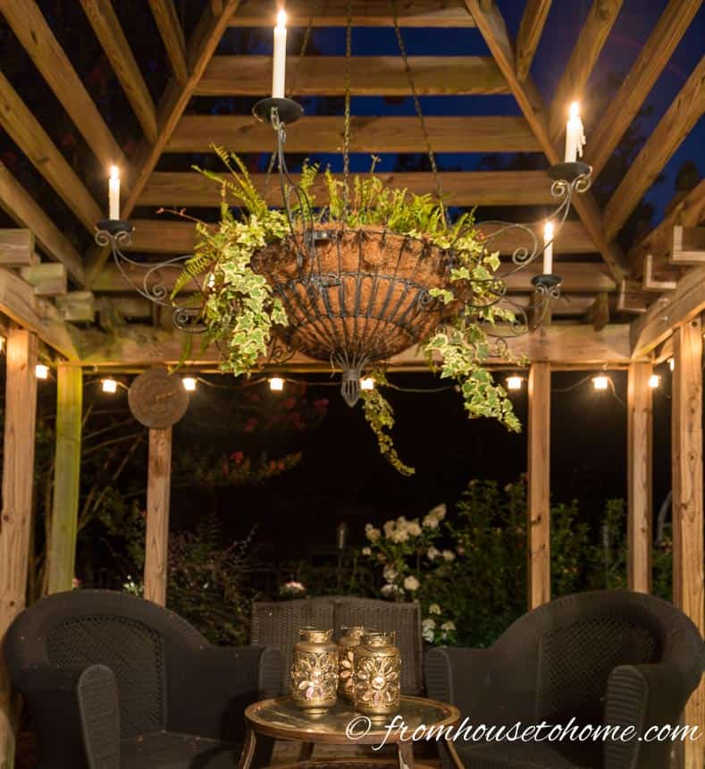 String lights hang from the edge of the gazebo | 10 Beautiful Ways To Light Your Garden
