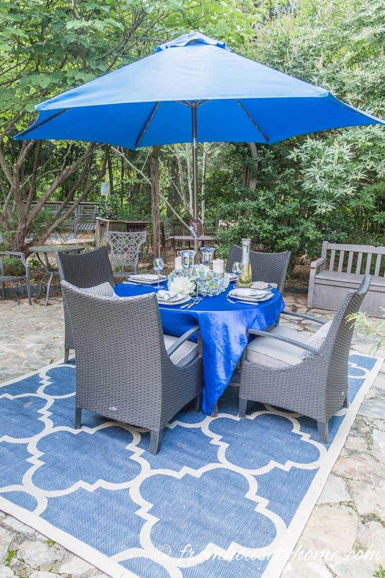 Outdoor rugs ground a seating area on a patio